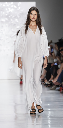 New York, NY, USA - September 7, 2017: A model walks runway for the Noon by Noor SpringSummer 2018 runway show during New York Fashion Week at Skylight Clarcson Sq., Manhattan