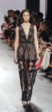 New York, NY, USA - September 7, 2017: A model walks runway for the Tadashi Shoji SpringSummer 2018 runway show during New York Fashion Week at Skylight Clarkson Sq., Manhattan Editorial