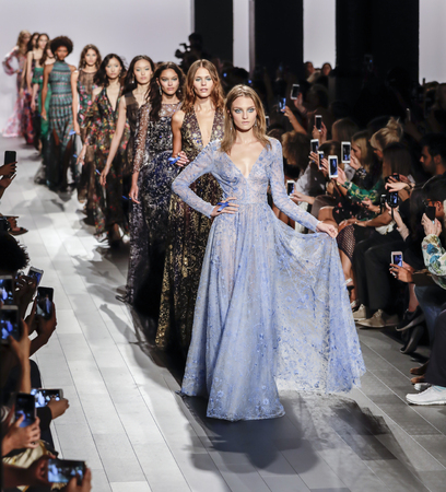 New York, NY, USA - September 7, 2017: Models walk runway for the Tadashi Shoji SpringSummer 2018 runway show during New York Fashion Week at Skylight Clarkson Sq., Manhattan Editorial