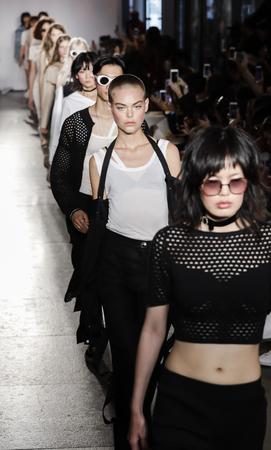 New York, NY, USA - September 12, 2017: Models walk runway for the Calvin Luo SpringSummer 2018 runway show during New York Fashion Week at Whitney Museum Of American Art, Manhattan