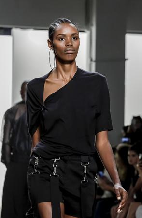 New York, NY, USA - September 11, 2017: A model walks runway for the Hakan Akkaya SpringSummer 2018 runway show during New York Fashion Week at Skylight Clarkson Sq., Manhattan Sajtókép