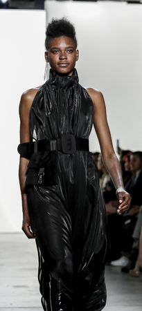 New York, NY, USA - September 11, 2017: A model walks runway for the Hakan Akkaya SpringSummer 2018 runway show during New York Fashion Week at Skylight Clarkson Sq., Manhattan Editorial