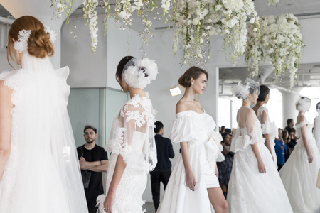 New York, NY, USA - October 5, 2017: Models show out a dress by Georgina Chapman and Keren Craig for Marchesa and Notte Fall/Winter 2018 Bridal Presentation during New York Bridal Week at Canoe Studio, Manhattan