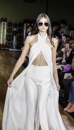 New York, NY, USA - October 6, 2017: A model walks runway for RIVINI & Alyne FallWinter 2018 Bridal Collection by Rita Vinieris at TMPL GYM during New York Bridal week, Manhattan