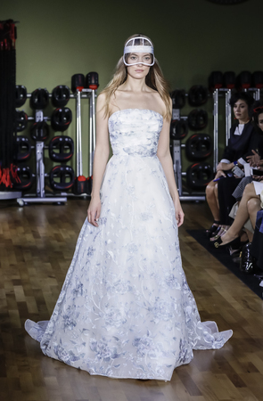 New York, NY, USA - October 6, 2017: A model walks runway for RIVINI & Alyne FallWinter 2018 Bridal Collection by Rita Vinieris at TMPL GYM during New York Bridal week, Manhattan