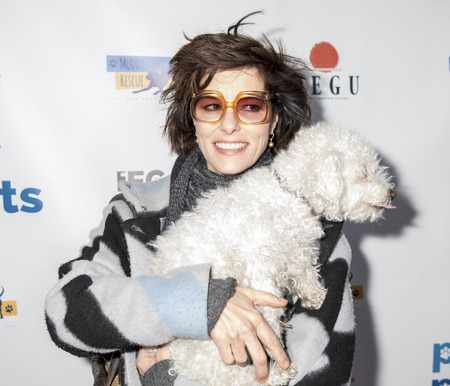 New York, NY, USA - December 19, 2017: Actress Parker Posey with her dog Gracie attend Paw Prints 1st Annual Paw-liday party screening of 'Best in Show' at IFC center Editorial