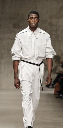 New York, NY, USA - February 6, 2018: A model walks runway for Carlos Campos FallWinter 2018 runway show during NY Fashion Wweek: Mens at Skylight Modern, Manhattan