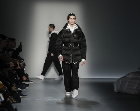New York, NY, USA - February 6, 2018: A model walks runway for Feng Chen Wang Fall/Winter 2018 runway show during NY Fashion Wweek: Men's at Pier 59 Studios, Manhattan Standard-Bild - 96579580