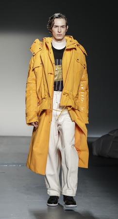 New York, NY, USA - February 6, 2018: A model walks runway for Feng Chen Wang FallWinter 2018 runway show during NY Fashion Wweek: Mens at Pier 59 Studios, Manhattan