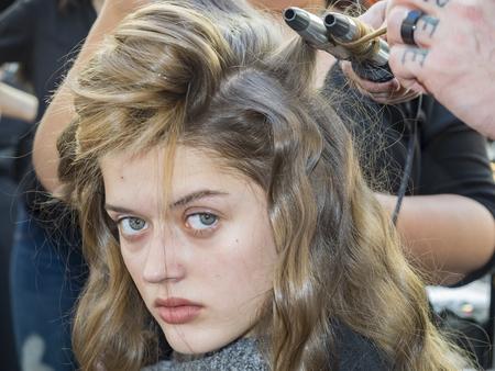 New York, NY, USA - February 8, 2018: A model prepares backstage for Tadashi Shoji FallWinter 2018 runway show during New York Fashion Week Spring Studios., Manhattan