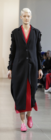 New York, NY, USA - February 8, 2018: A model walks runway for the Noon by Noor Fall/Winter 2018 runway show during New York Fashion Week at Spring Studios, Manhattan