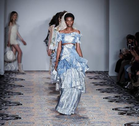 New York, NY, USA - February 10, 2018: Models walk runway for alice McCall FallWinter 2018 runway show during New York Fashion Wweek at Industria, Manhattan