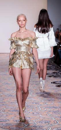 New York, NY, USA - February 10, 2018: A model walks runway for alice McCall FallWinter 2018 runway show during New York Fashion Wweek at Industria, Manhattan