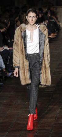 New York, NY, USA - February 12, 2018: A model walks runway for Dennis Basso FallWinter 2018 runway show during New York Fashion Week at Saint Bartholomews Episcopal Church, Manhattan