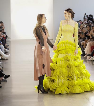 New York, NY, USA - Febbruary 14, 2018: Leanne Marshal with model walk runway for Leanne Marshall FallWinter 2018 runway show during New York Fashion Week at Spring Studios, Manhattan Editorial