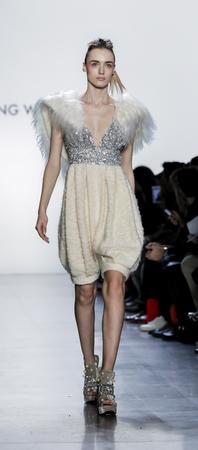 New York, NY, USA - February 10, 2018: A model walks runway for Son Jung Wan FallWinter 2018 runway show during NY Fashion Week at Spring Studios, Manhattan Editorial