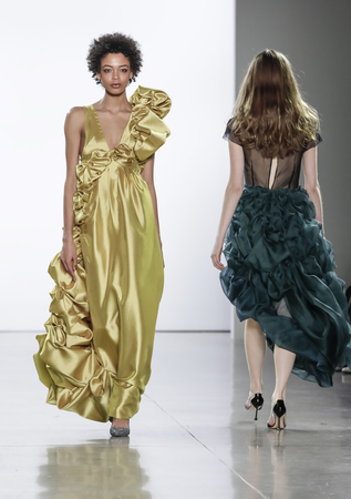 New York, NY, USA - February 13, 2018: A model walks runway for Vivienne Hu FallWinter 2018 runway show during NY Fashion Wweek at Spring Studios, Manhattan Editorial