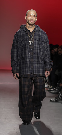 New York, NY, USA - February 5, 2018: A model walks runway for Willy Chavarria FallWinter 2018 runway show during NY Fashion Wweek: Mens at Pier 59 Studios, Manhattan