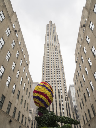 New York, NY, USA - April 1, 2018: Easter Bunny with Easter egg in front of Rockefeller Center, Manhattan Editorial