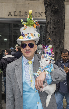 New York, NY, USA - April 1, 2018: Fashion designer Antony Rubio with Kimba attend 2018 New York Easter Parade and Bonnet Festival on 5th Avenue, Manhattan near St.Patrick's Cathedral. 에디토리얼