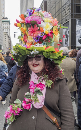 New York, NY, USA - April 1, 2018: Unidentified people in costumes attend 2018 New York Easter Parade and Bonnet Festival on 5th Avenue, Manhattan near St.Patrick's Cathedral.