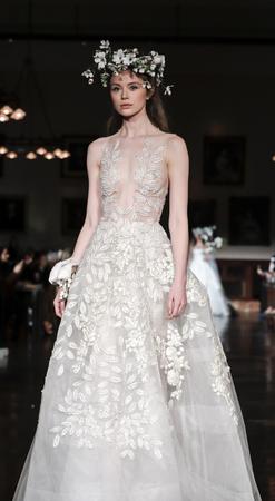 New York, NY, USA - April 12, 2018: A model walks runway for Reem Acra Bridal SpringSummer 2019 collection during NY Bridal Wweek at NY Public Library, Manhattan