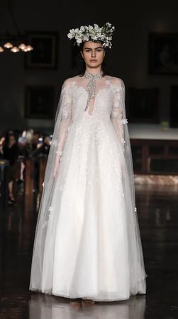 New York, NY, USA - April 12, 2018: A model walks runway for Reem Acra Bridal SpringSummer 2019 runway show during NY Bridal Wweek at NY Public Library, Manhattan Editorial