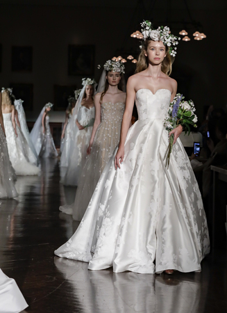 New York, NY, USA - April 12, 2018: Models walk runway for Reem Acra Bridal SpringSummer 2019 collection during NY Bridal Wweek at NY Public Library, Manhattan Editorial