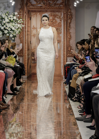 NEW YORK, NY, USA - APRIL 12: A model walks the runway at the Theia runway show during New York Bridal Week at the Theia Showroom, Manhattan