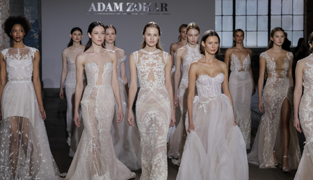 NEW YORK, NY, USA - APRIL 14, 2018: Models walk the runway for Adam Zohar collection during New York Bridal Week at Industria, Manhattan
