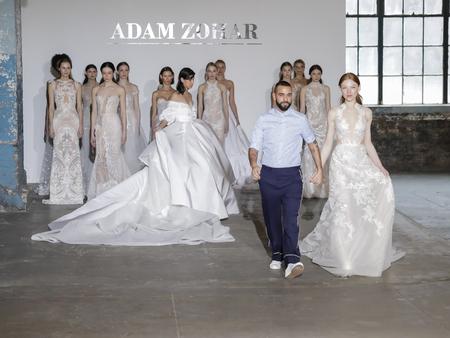 NEW YORK, NY, USA - APRIL 14, 2018: Fashion designer Adam Zohar with models walk runway for Adam Zohar collection during New York Bridal Week at Industria, Manhattan