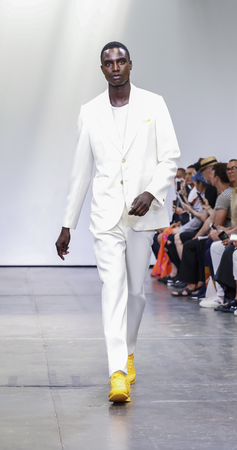 New York, NY, USA - July 9, 2018: A model walks runway for Carlos Campos Spring/Summer 2019 collection during NY Fashion Week: Men's at Industria Studios, Manhattan