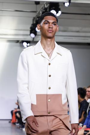 New York, NY, USA - July 9, 2018: A model walks runway for Carlos Campos SpringSummer 2019 collection during NY Fashion Week: Mens at Industria Studios, Manhattan