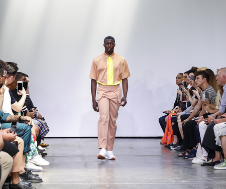 New York, NY, USA - July 9, 2018: A model walks runway for Carlos Campos SpringSummer 2019 collection during NY Fashion Week: Mens at Industria Studios, Manhattan