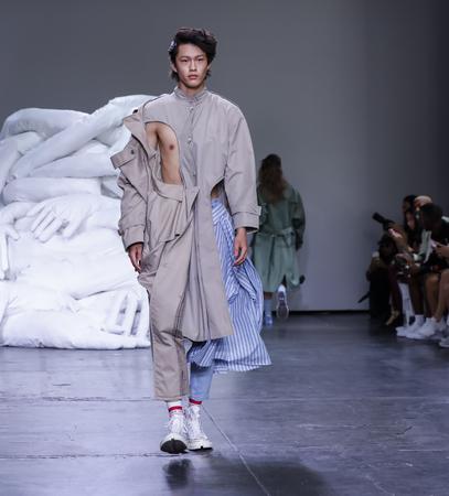 New York, NY, USA - July 10, 2018: A model walks runway for Feng Chen Wang SpringSummer 2019 runway show during NY Fashion Wweek: Mens at Industria Studios, Manhattan Editöryel