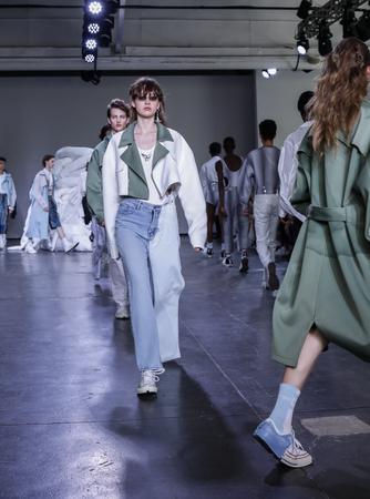 New York, NY, USA - July 10, 2018: Models walk runway for Feng Chen Wang SpringSummer 2019 runway show during NY Fashion Wweek: Mens at Industria Studios, Manhattan