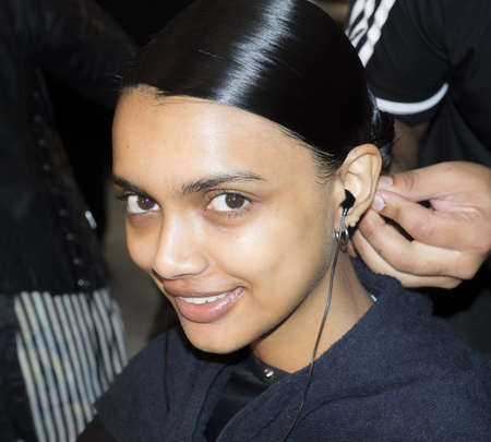 New York, NY, USA - September 11, 2018: A model prepares backstage for the Naeem Khan SpringSummer 2019 runway show during New York Fashion Week at Spring Studios, Manhattan Editöryel