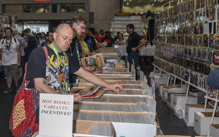 New York, NY, USA - October 4, 2018: Comic Books vendor sells comics during Comic Con 2018 at The Jacob K. Javits Convention Center in New York City. Editöryel