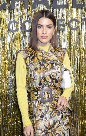 New York, NY, USA - February 13, 2019: Camila Coelho attends the Michael Kors Collection Fall 2019 Runway Show during New York Fashion Week at Cipriani Wall Street, Manhattan Sajtókép