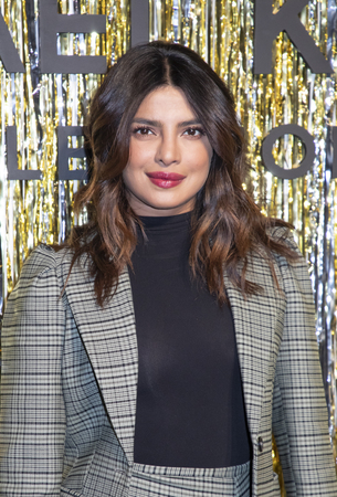 New York, NY, USA - February 13, 2019: Priyanka Chopra attends the Michael Kors Collection Fall 2019 Runway Show during New York Fashion Week at Cipriani Wall Street, Manhattan