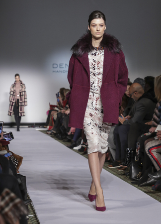 New York, NY, USA - February 11, 2019: A model walks runway for Dennis Basso FallWinter 2019 Collection during New York Fashion Week at Cipriani 42nd Street, Manhattan