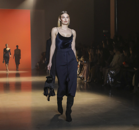 New York, NY, USA - February 8, 2019: A model walks runway for Cushnie FallWinter 2019 collection during New York Fashion at Spring Studios, Manhattan