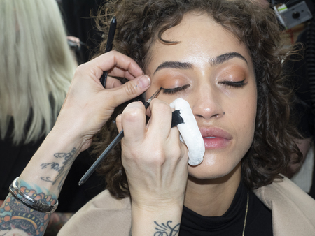New York, NY, USA - February 8, 2019: A model prepares backstage for the  Cushnie FallWinter 2019 collection during New York Fashion at Spring Studios, Manhattan 報道画像
