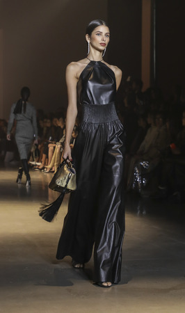 New York, NY, USA - February 8, 2019: A model walks runway for Cushnie Fall/Winter 2019 collection during New York Fashion at Spring Studios, Manhattan