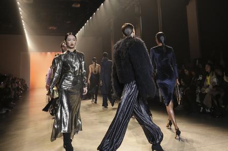 New York, NY, USA - February 8, 2019: Models walk runway for Cushnie FallWinter 2019 collection during New York Fashion at Spring Studios, Manhattan