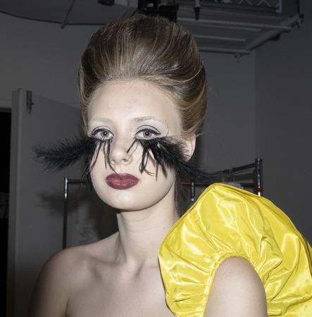 New York, NY, USA - April 12, 2019: A model prepares backstage for Francesca Miranda Spring 2020 Presentation during New York Bridal Week at Canoe Studio, Manhattan Фото со стока - 120755898