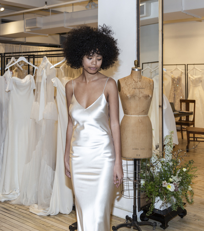 New York, NY, USA - April 13, 2019: A models shows out dress for Savannah Miller Spring 2020 Presentation during New York Bridal Week at 43 West 24th Street, Manhattan Фото со стока - 120756043