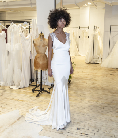 New York, NY, USA - April 13, 2019: A models shows out dress for Savannah Miller Spring 2020 Presentation during New York Bridal Week at 43 West 24th Street, Manhattan Editorial