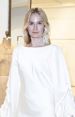 New York, NY, USA - April 13, 2019: A models shows out dress for Savannah Miller Spring 2020 Presentation during New York Bridal Week at 43 West 24th Street, Manhattan Фото со стока - 120756098