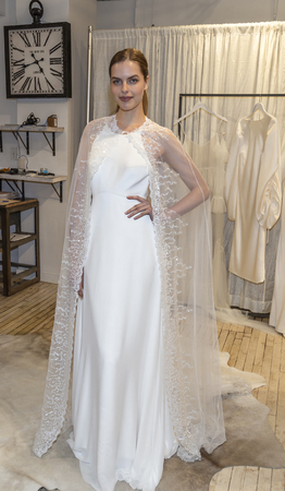New York, NY, USA - April 13, 2019: A models shows out dress for Savannah Miller Spring 2020 Presentation during New York Bridal Week at 43 West 24th Street, Manhattan Sajtókép